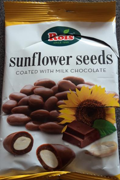 Fotografie - sunflower seeds coated with milk chocolate Rois