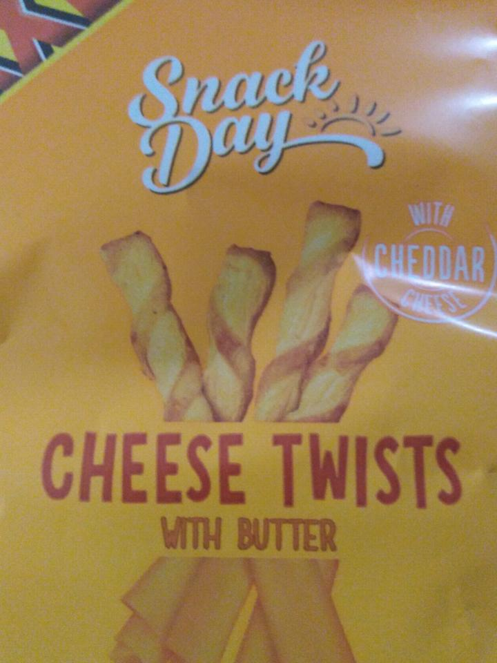 Fotografie - Cheese twists with butter - Snack Day